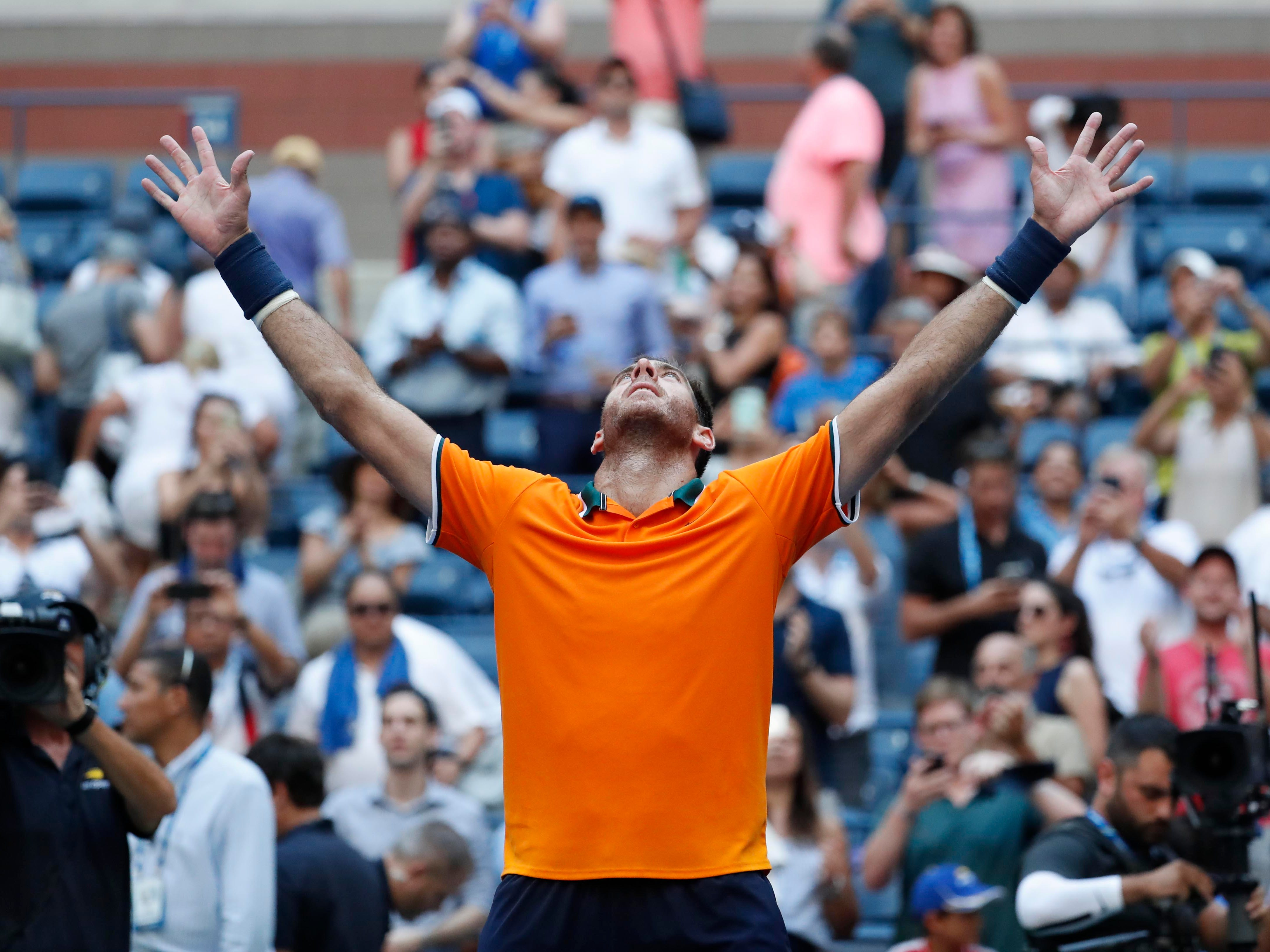 Juan Martin Del Potro of Argentina celebrates after his 6-7(5), 6-3, 7-6(4), 6-2 win against John Isner of the USA in the quarterfinals Tuesday.