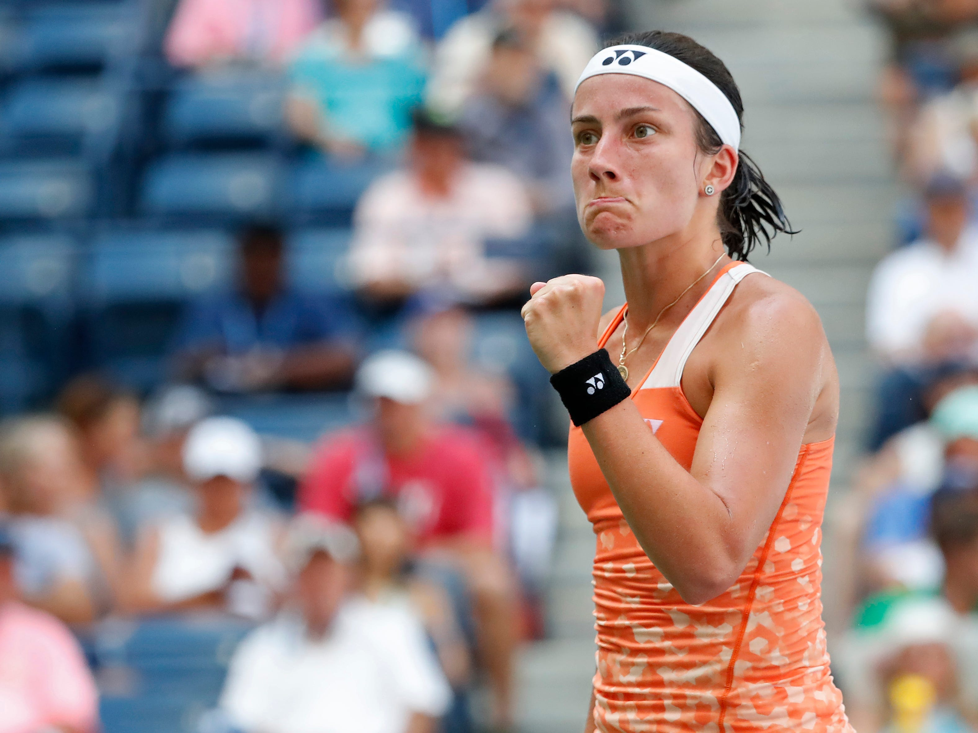 Anastasija Sevastova of Latvia celebrates after winning the first set against Sloane Stephens of the United States in a quarterfinal match at the U.S. Open.