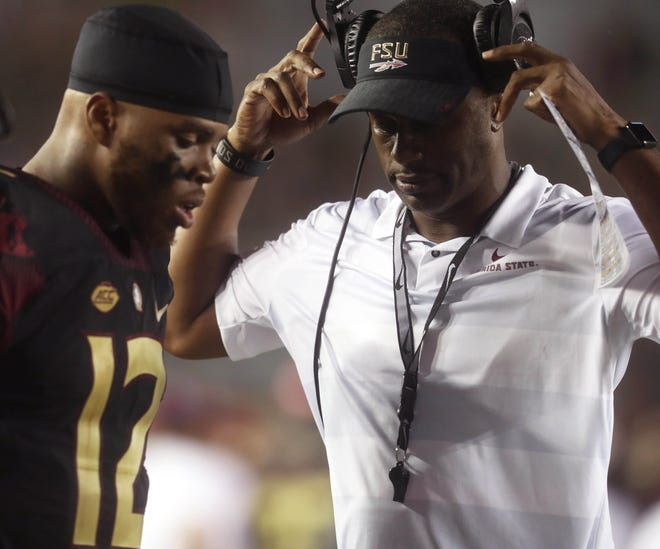 FSU head coach Willie Taggart and quarterback Deondre Francois talk during the loss against Virginia Tech.
