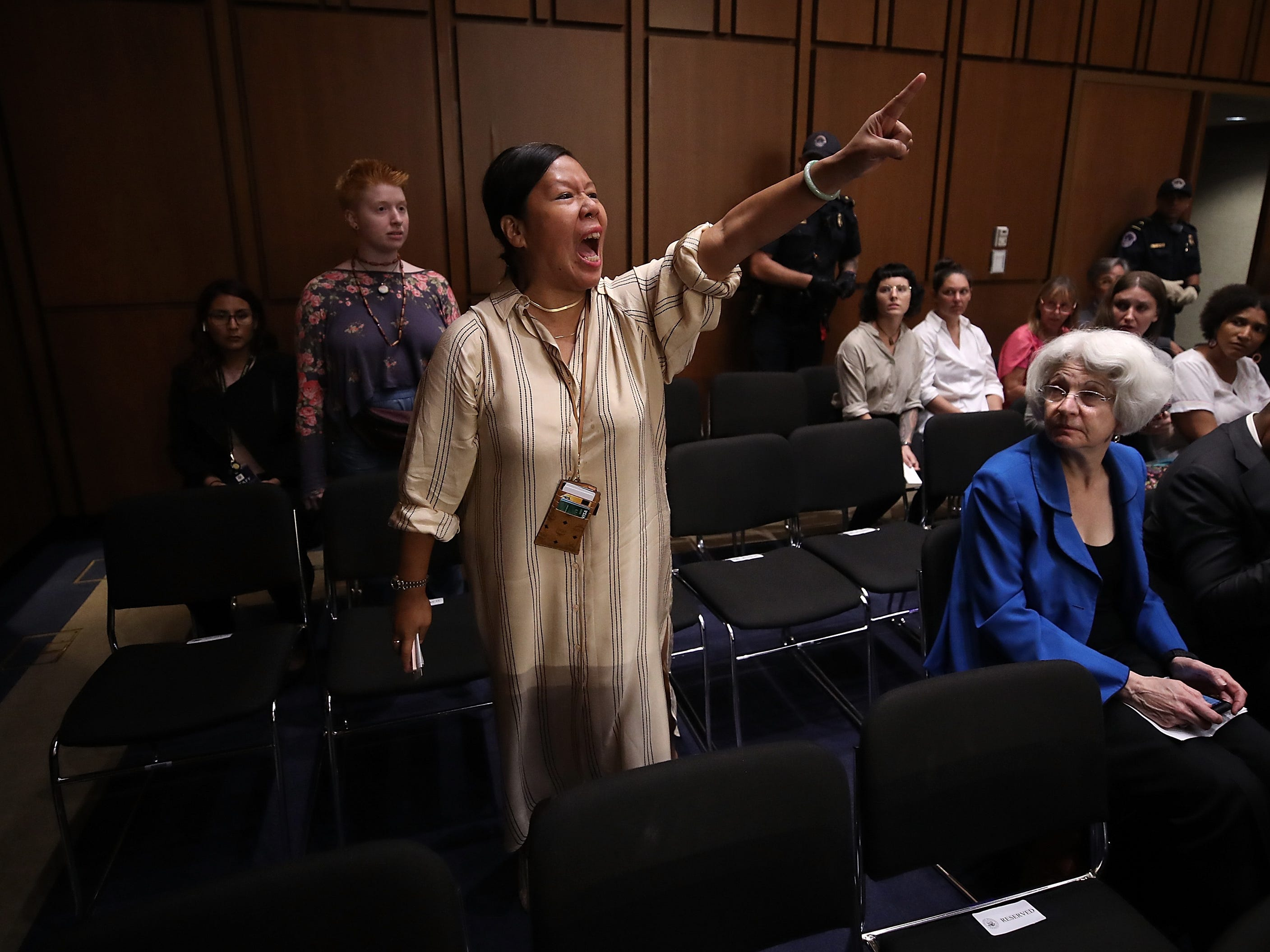 WASHINGTON, DC - SEPTEMBER 04:  Protesters disrupt the start of the Supreme Court nominee Judge Brett Kavanaugh's confirmation hearing before the Senate Judiciary Committee in the Hart Senate Office Building on Capitol Hill September 4, 2018 in Washington, DC. Kavanaugh was nominated by President Donald Trump to fill the vacancy on the court left by retiring Associate Justice Anthony Kennedy.  (Photo by Mark Wilson/Getty Images) ORG XMIT: 775208795 ORIG FILE ID: 1026647630