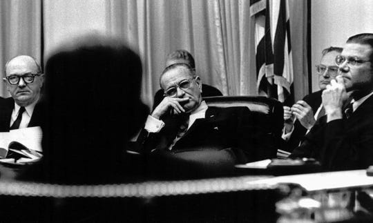 President Lyndon B. Johnson, flanked by State Secretary Dean Rusk, left, and Defense Secretary Robert McNamara, right, listens on Jan. 28, 1966, during discussion in the White House on the resumption of bombing North Vietnam.