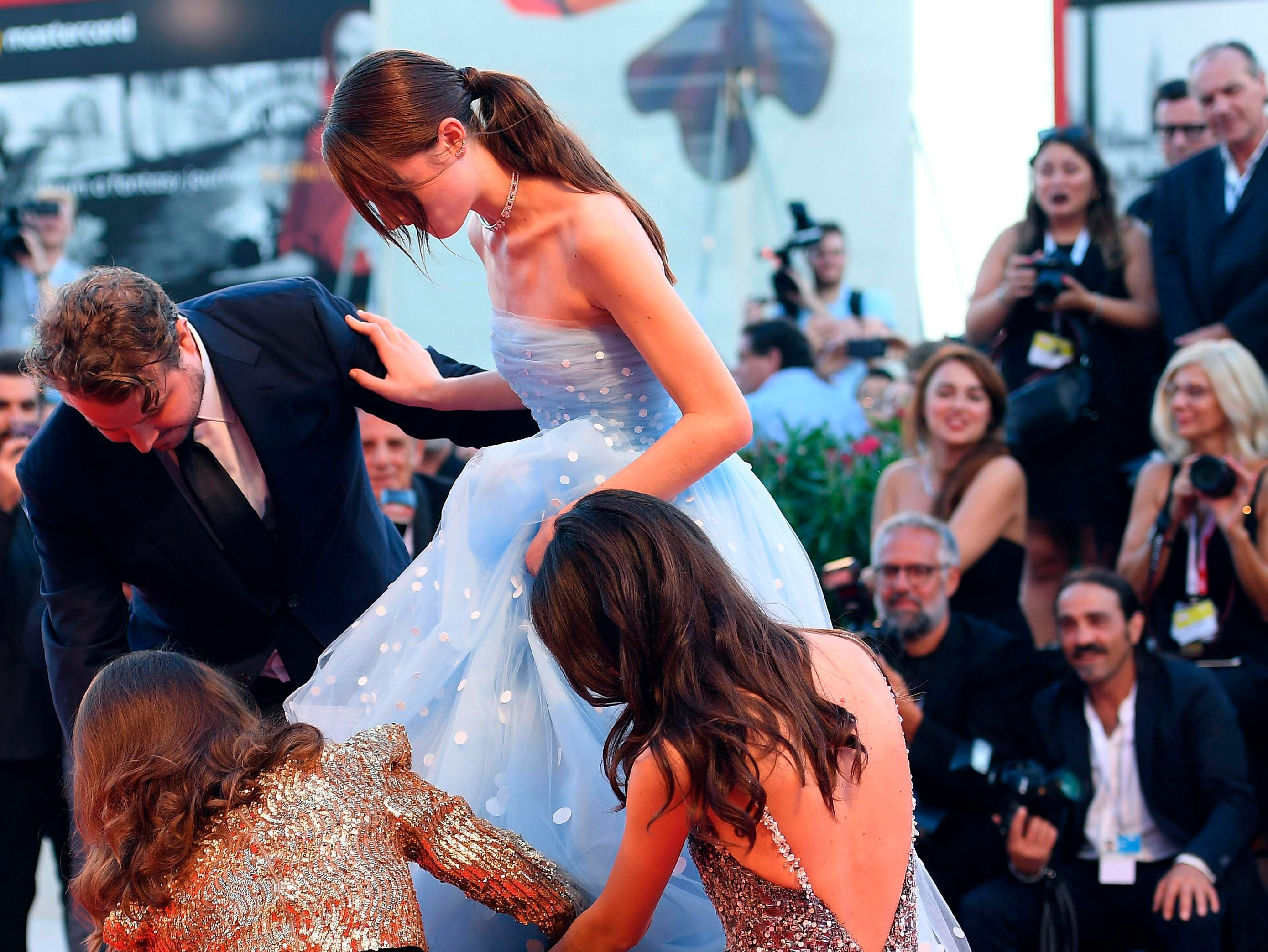 Director Brady Corbet, left, and Natalie Portman, bottom left, and Stacy Martin, bottom right, adjusts the dress of actress Raffey Cassidy at the premiere of the film 'Vox Lux' at the 75th edition of the Venice Film Festival in Venice, Italy, on Tuesday,. Click through to see all the action thus far.