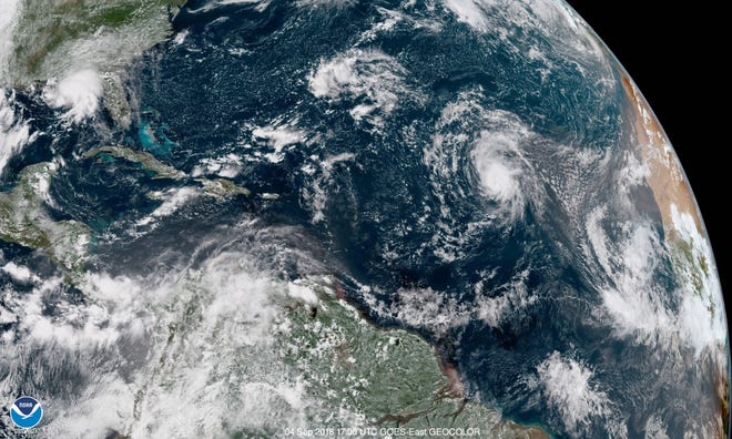 A satellite image from Sept. 4, 2018, shows storms in various stages of formation across the Atlantic Ocean.