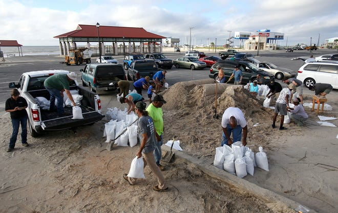 People fill sandbags at Long Beach Harbor on Sept. 4, 2018, in Long Beach, Miss., in advance of Tropical Storm Gordon, which is continuing to strengthen and is expected to become a hurricane late Tuesday when it hits the central U.S. Gulf Coast.