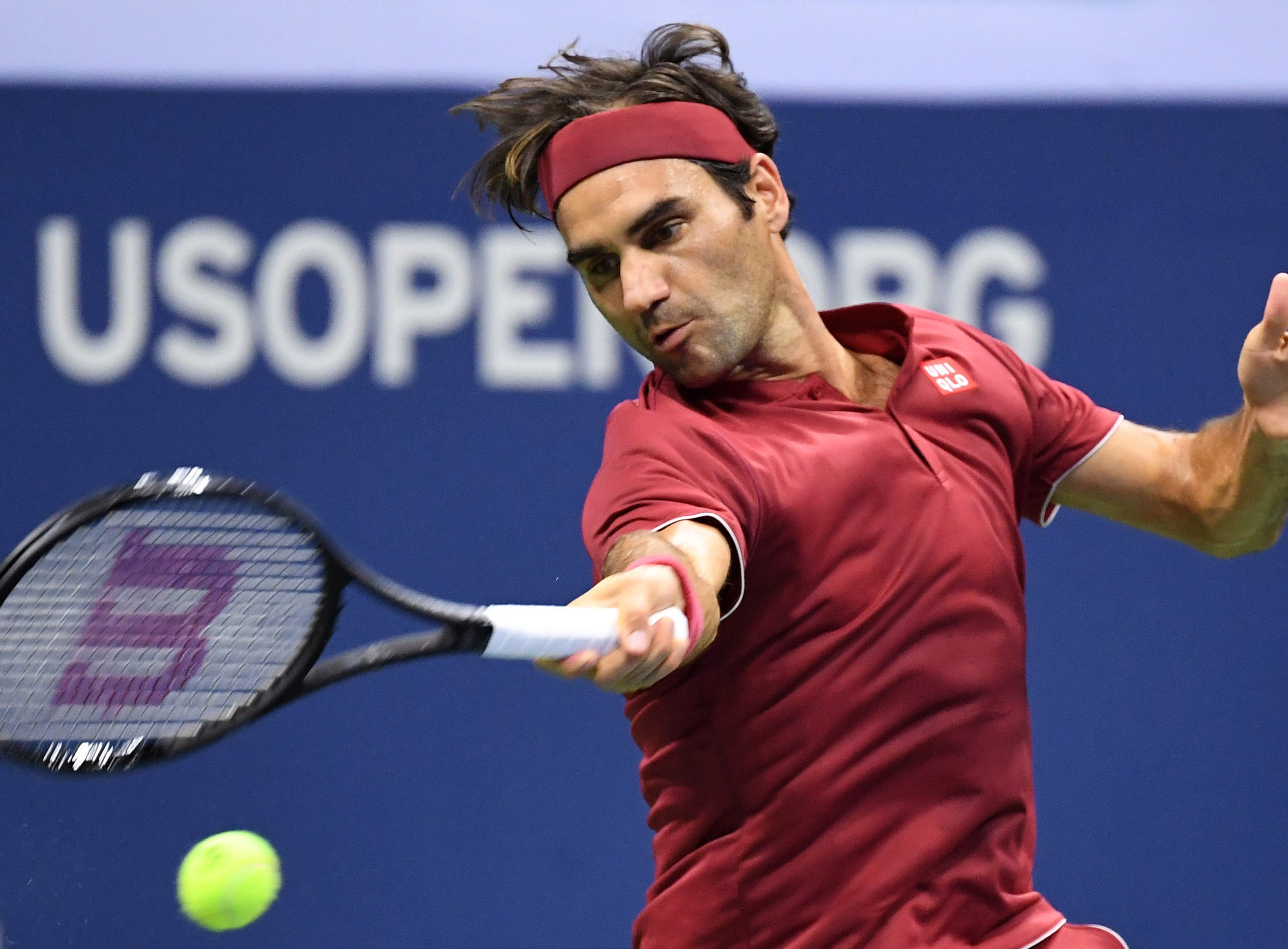 Roger Federer returns a shot against John Millman in the fourth round.