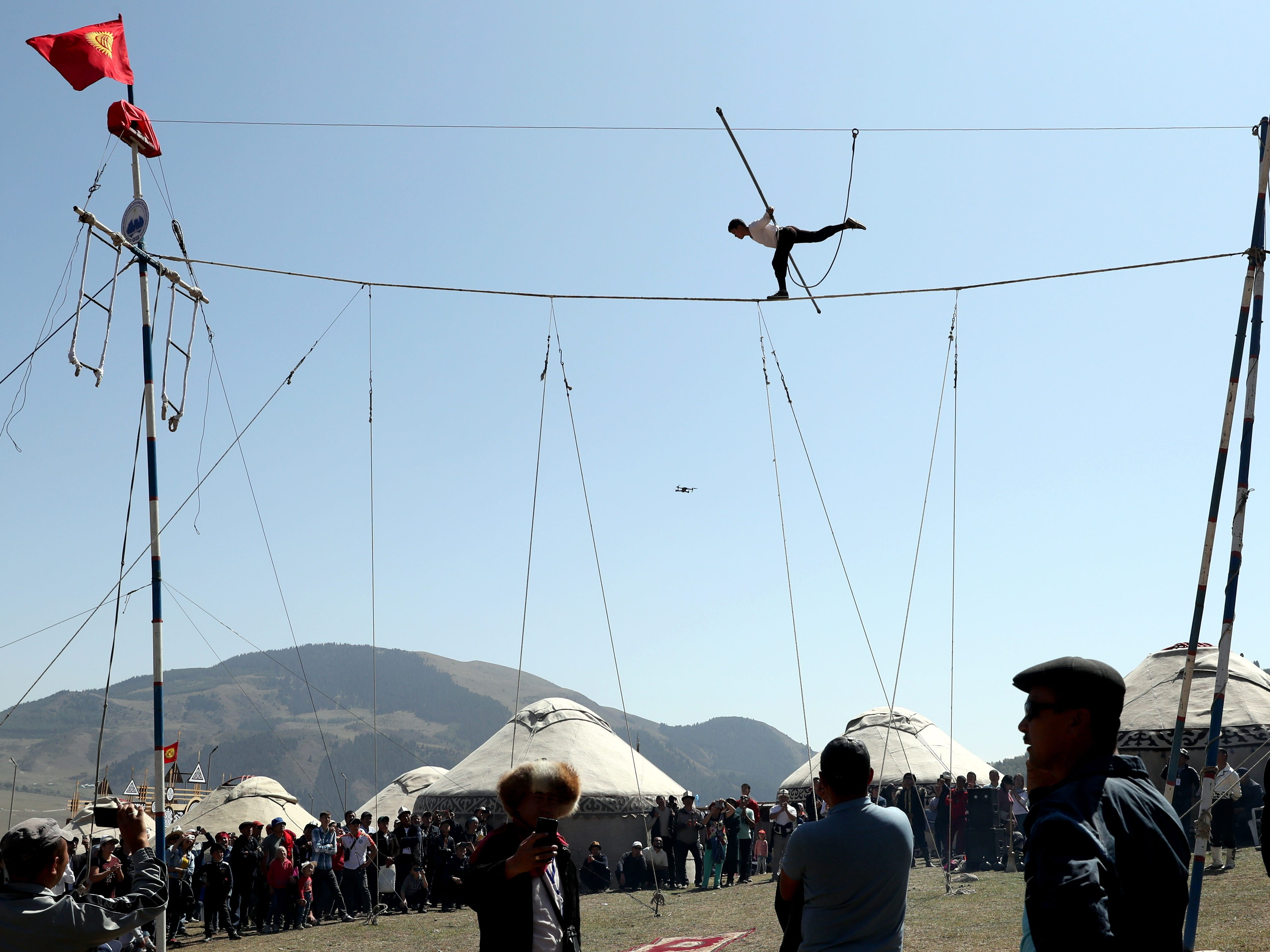 A tightrope walker performs during the third World Nomad Games in Cholpon-Ata, Kyrgyzstan, Sept. 4, 2018.