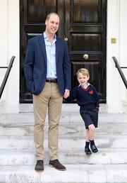 Prince William with his son Prince George on his first day of school on Sept. 7, 2017 in London. The picture was  taken at Kensington Palace shortly before they left for school.