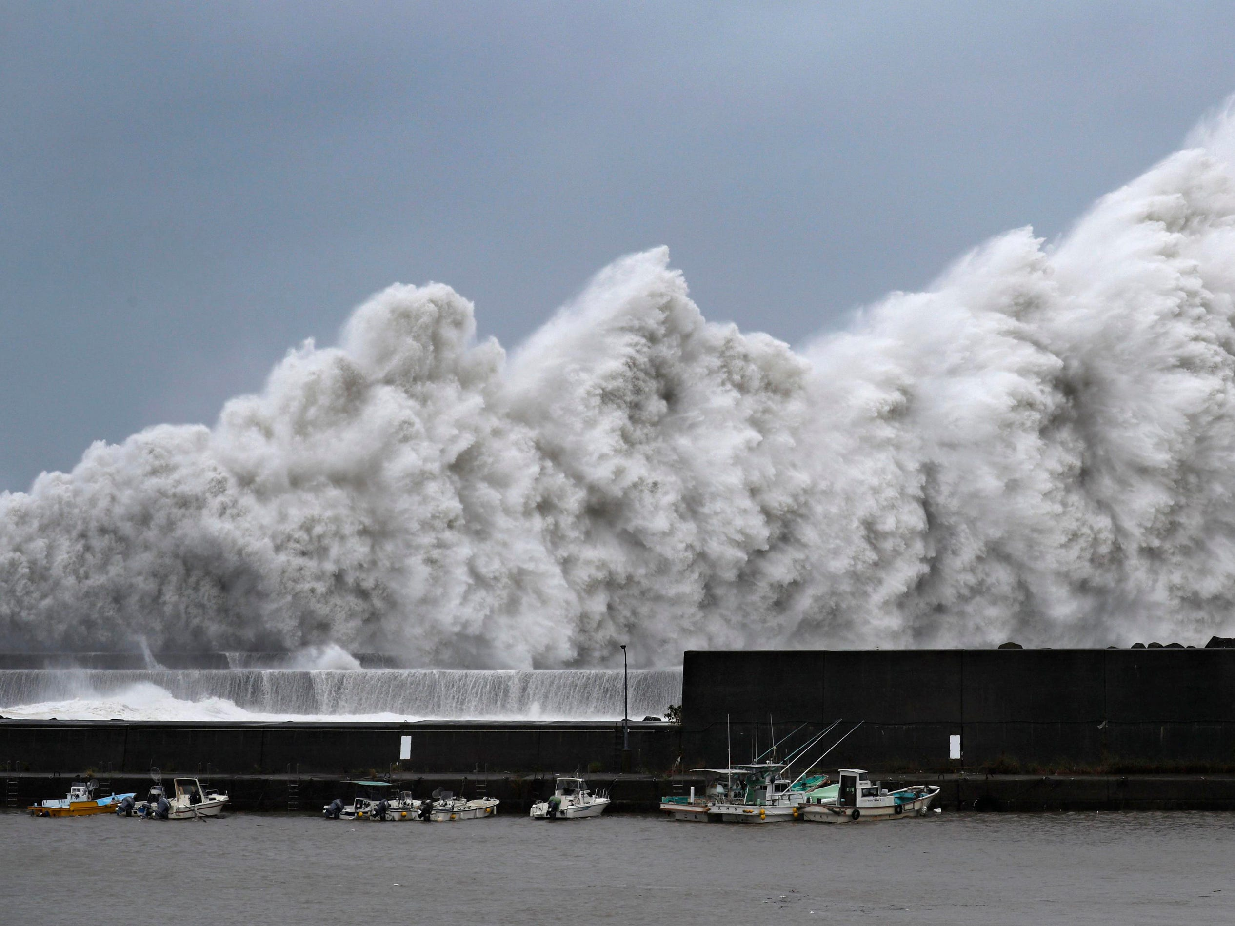 CORRECTS NAME OF PHOTOGRAPHER - High waves hit breakwaters at a port of Aki, Kochi prefecture, western Japan, Tuesday Sept. 4, 2018. Powerful Typhoon Jebi is approaching Japan's Pacific coast and forecast to bring heavy rain and high winds to much of the country. (Ichiro Banno/Kyodo News via AP) ORG XMIT: XEH801