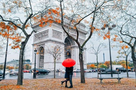 Couple Under Umbrella At Rain In Paris