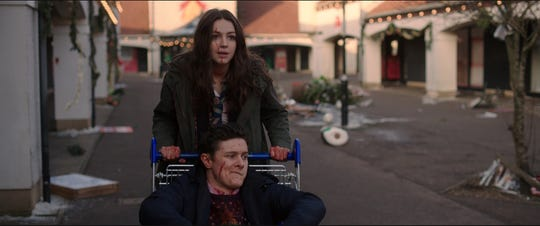 """Anna (Ella Hunt) and her best friend John (Malcolm Cumming) get a brief respite from the undead in """"Anna and the Apocalypse."""""""