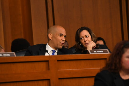 Sen. Corey Booker (D-N.J.) and Sen. Kamala Harris (D-Calif.) confer during the confirmation hearing for Supreme Court Associate Justice nominee Brett Kavanaugh on Sept. 4, 2018 in Washington.