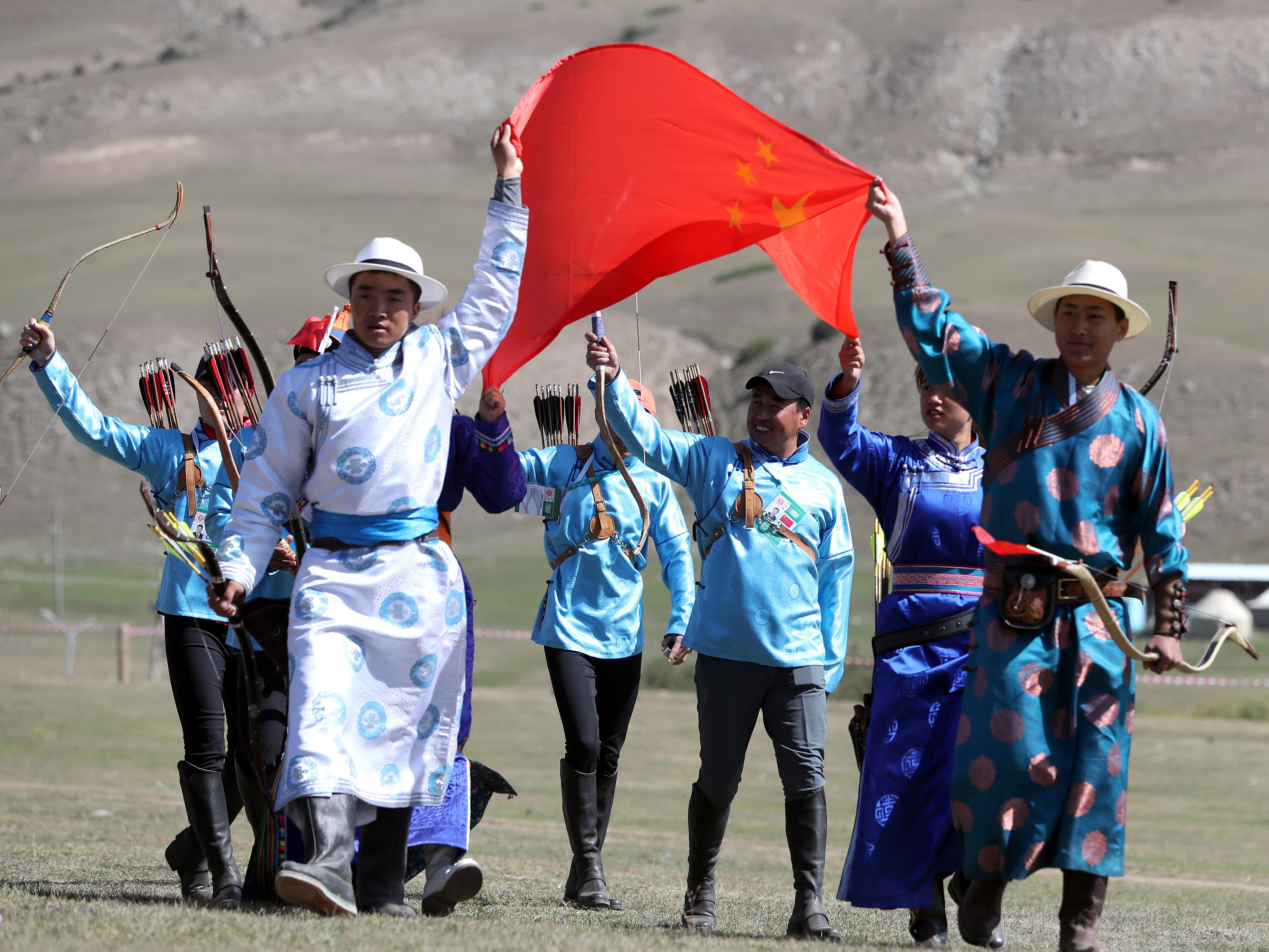 A team parades during the third World Nomad Games in Cholpon-Ata, Kyrgyzstan, Sept. 4, 2018.