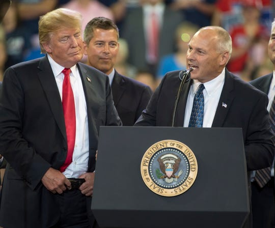 President Donald Trump, left, listens as Pete Stauber, Republican candidate for the Minnesota 8th Congressional District, speaks during a rally at an arena in Duluth, Minnesota, on June 20, 2018.