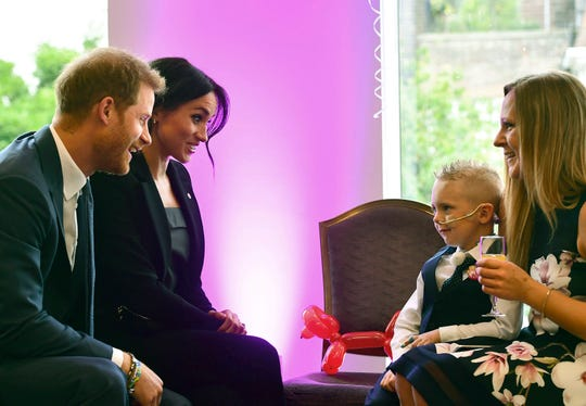 Prince Harry and Duchess Meghan of Sussex meet 4-year-old Mckenzie Brackley and his mother before the annual WellChild Awards at the Royal Lancaster Hotel in London, Sept. 4, 2018.