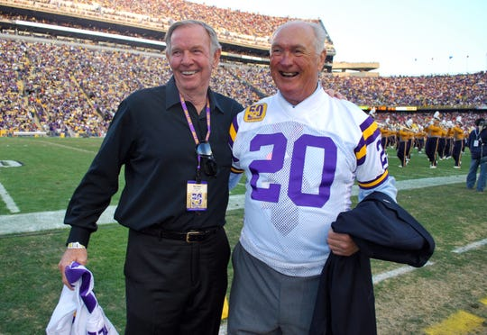 Max Fugler (right) poses with Billy Cannon during LSU's 50th anniversary celebration of its 1958 National Championship team.