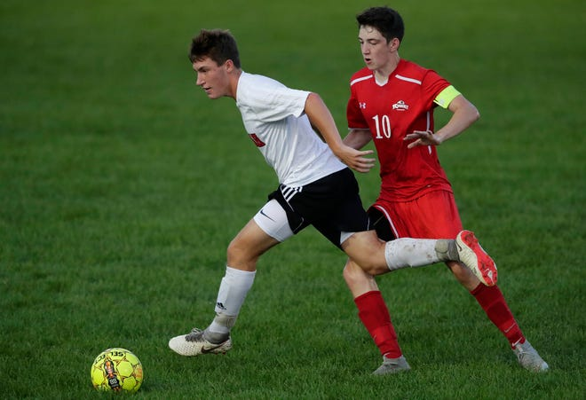 Neenah's Thomas Priest (2) looks to pass against Kimberly's Dawson DeBoer during their boys soccer game Sept. 4 at Papermaker Field in Kimberly.  Dan Powers/USA TODAY NETWORK-Wisconsin