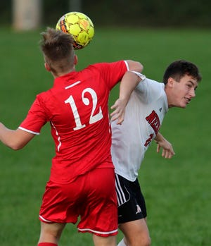 Kimberly's Nick Riffe, 12, goes up against Neenah's Thomas Priest during their boys soccer game Tuesday at Papermaker Field in Kimberly.