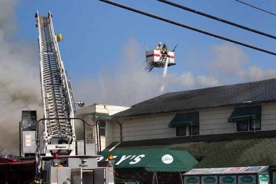 Fireman from surrounding towns work to put out a huge fire at Caffrey's Tavern on Route 9 in Lacey Township.