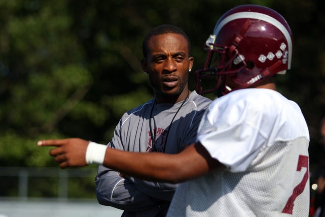 Former NFL player Charlie Rogers is now a youth football coach.