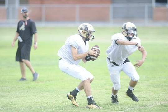 Kallin Sipe fakes a handoff to Esai Jaques before dropping back to pass at a practice held Sept. 4, 2018. Sipe will get his first start of the year at quarterback against Midland Lee Friday.