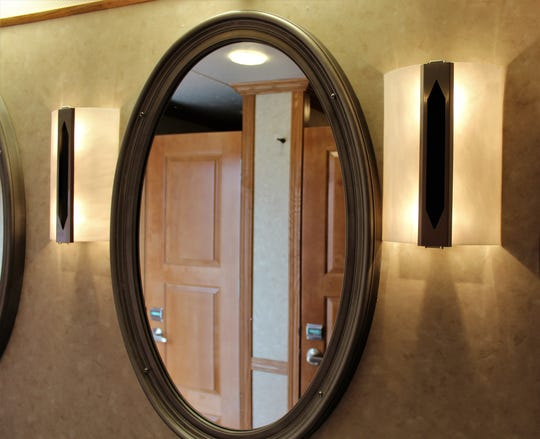 Mirror, mirror on the wall, have you a nicer stall? The interior of the Presidential Rest Stop features real wood doors, cabinets and flooring.