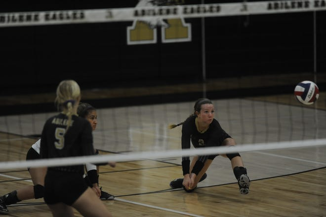 Bailey Proctor dives for a ball Tuesday Sept. 8, 2018 during Abilene High's match against Stephenville.