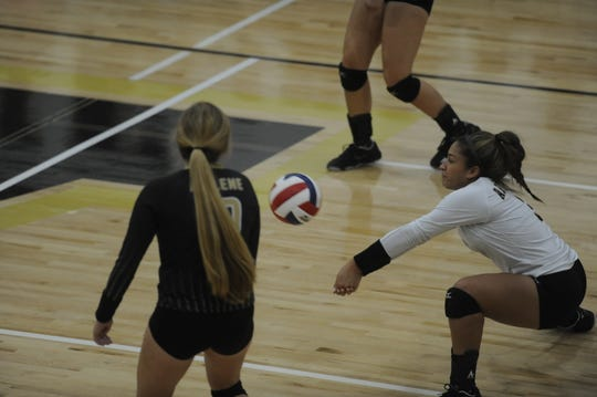 Jaiden Franklin bumps a serve Tuesday Sept. 8, 2018 during Abilene High's match against Stephenville.