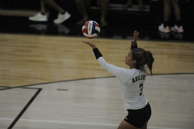 Jaiden Franklin (3) tosses up for a serve Tuesday, Sept. 11, 2018, during Abilene High's match against Hurst L.D. Bell.