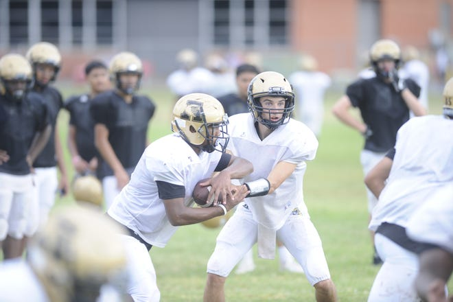 Kallin Sipe  hands off to Phonzo Dotson during a practice held Sept. 4, 2018. Sipe will get his first start of the year at quarterback against Midland Lee Friday.