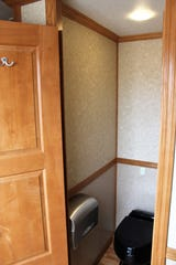 A stall in the Presidential Rest Stop, with maple doors.