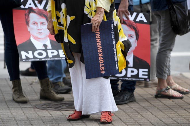 A group gathered to protest against the hearing of Supreme Court nominee Judge Brett Kavanaugh in front of the federal building downtown on Sept. 5.