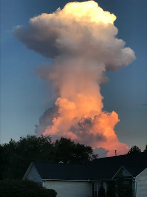 This enormous cloud appeared Monday morning in the skies south of Asheville, creating quite a stir on social media. Called cumulus congestus, or a cumulus tower, it appeared to glow due to the setting sun shining on that side of it. They occur in areas of deep moist convection with very strong updrafts that causes the tops to reach great heights and are much taller than they are wide.