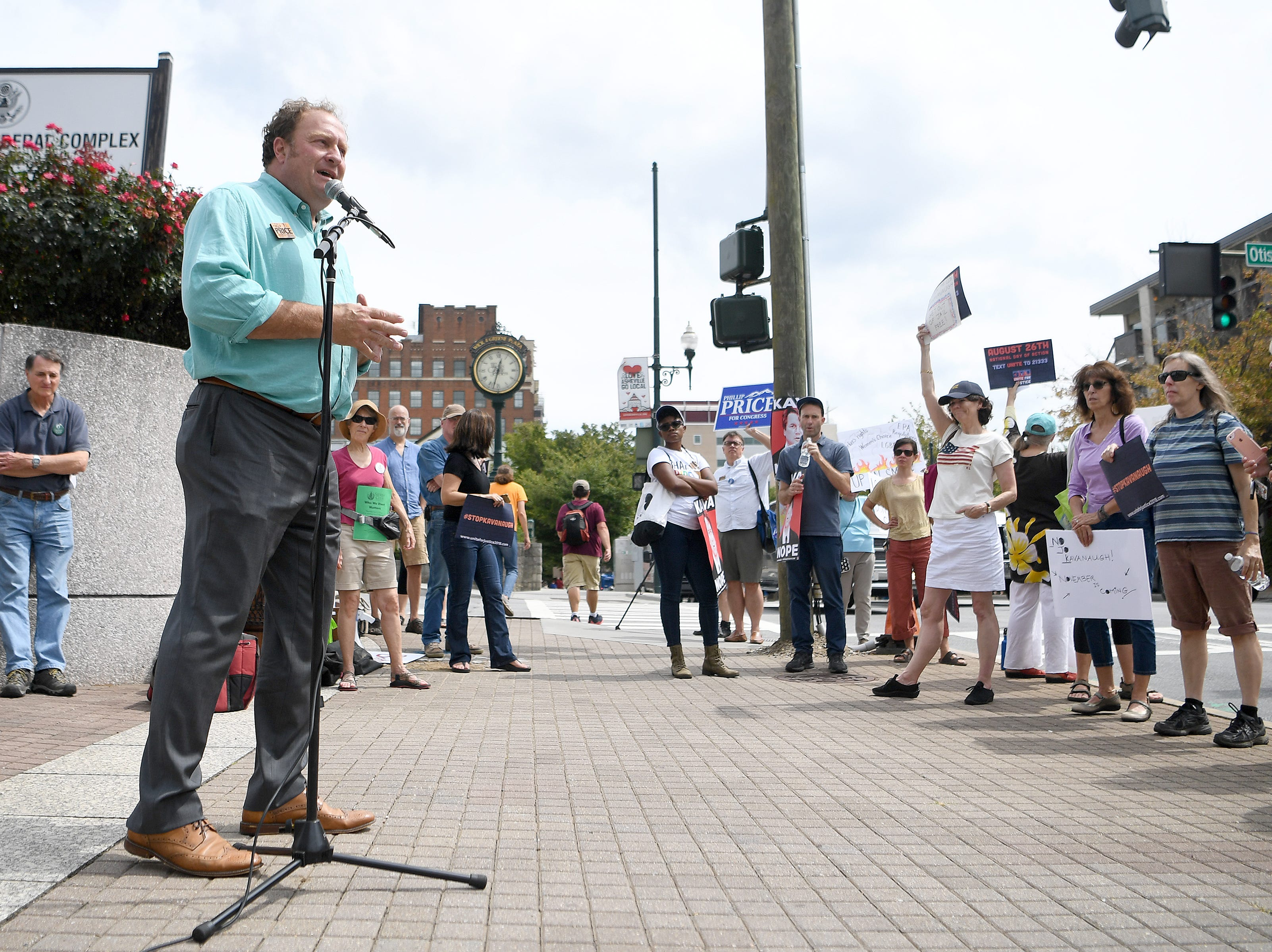 Congressional candidate Phillip Price addresses the crowd during a protest against the hearing of Supreme Court nominee Judge Brett Kavanaugh in front of the federal building downtown on Wednesday, Sept. 5, 2018.