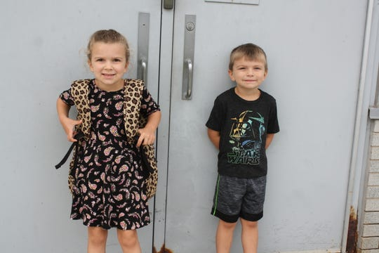 Charles F. Johnson, Jr. Elementary School first grader Cora Schappert, 6, and Eddie Schappert, 4, both of Endicott, wait for the first day of school to begin Wednesday. While Eddie won't be starting school this year, he tagged along to support his sister.