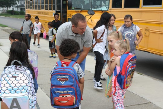 Students at Charles F. Johnson, Jr. Elementary School in Endicott learn where to go on the first day of school Wednesday morning.