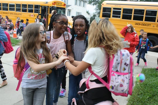Students at Charles. F Johnson, Jr.  Elementary School in Endicott are reunited during the first day of school Wednesday morning.
