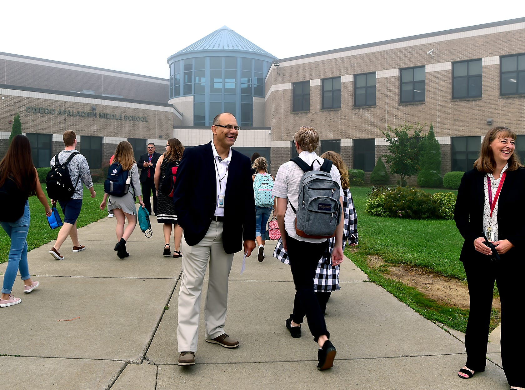 Owego Apalachin Middle School Principal and Assistant Principal, Tom Beatty and Emily Crawford, greet students during the first day of classes at Owego Apalachin Middle School and Owego Free Academy, Wednesday, September 5, 2018.