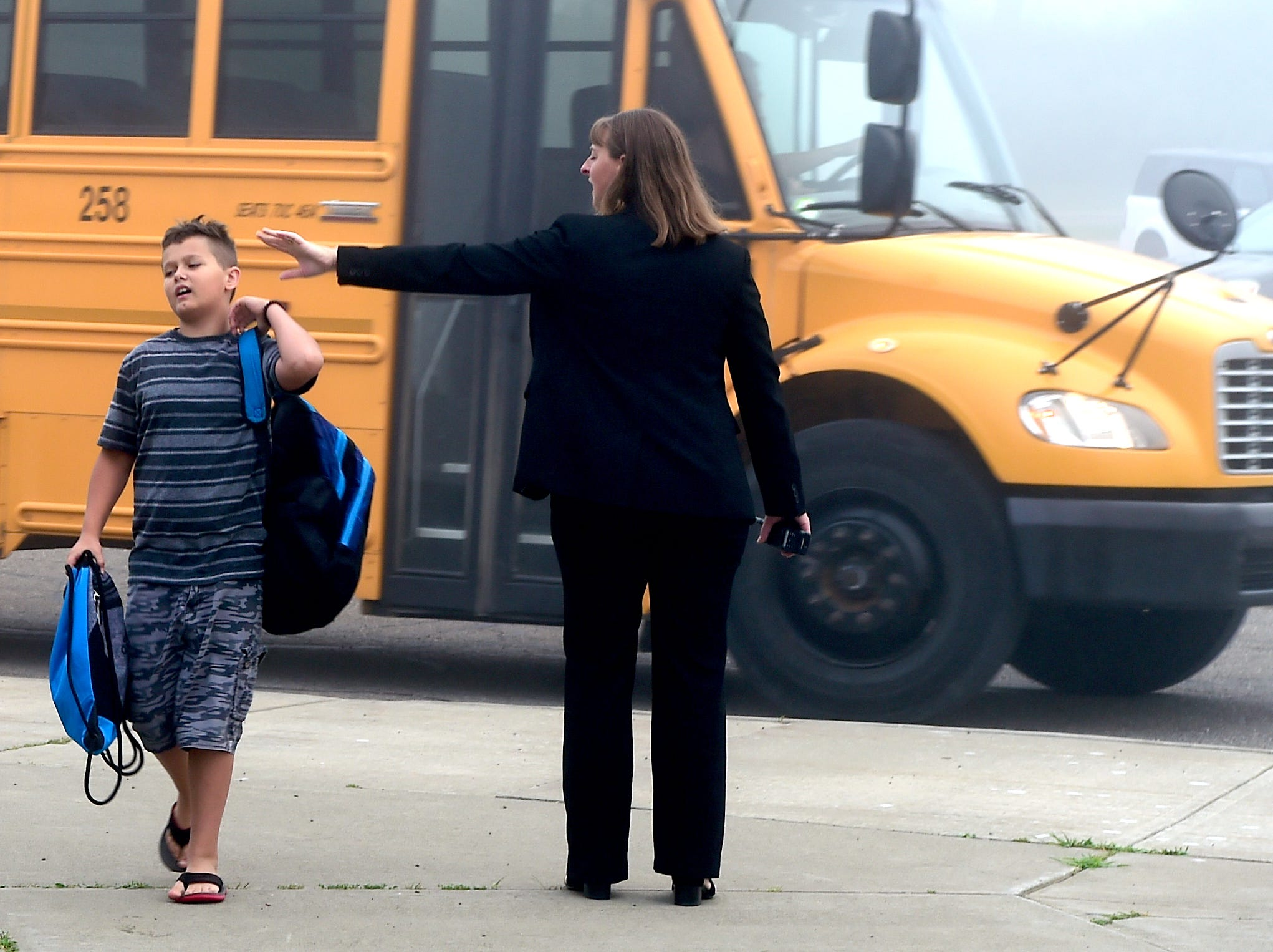 Owego Apalachin Middle School Assistant Principal Emily crawford greets students during the morning drop-off at the first day of classes at Owego Apalachin Middle School and Owego Free Academy, Wednesday, September 5, 2018.