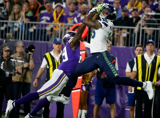 Seahawks wide receiver Brandon Marshall catches a pass over Minnesota Vikings defensive back Xavier Rhodes during an Aug. 24 preseason game in Minneapolis.