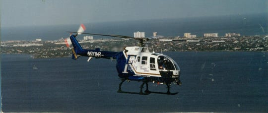 A look at an early First Flight helicopter flying over the Indian River with Indian Harbour Beach to the East in the background.