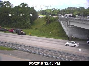 Authorities were stopped on Interstate 95 at mile marker 177 for an investigation into a stolen car.