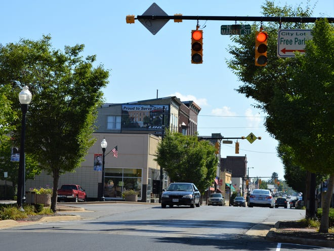 Cars drive on the newly paved section of Harding Way in Galion on Wednesday morning that has been re-opened following an emergency water main break.