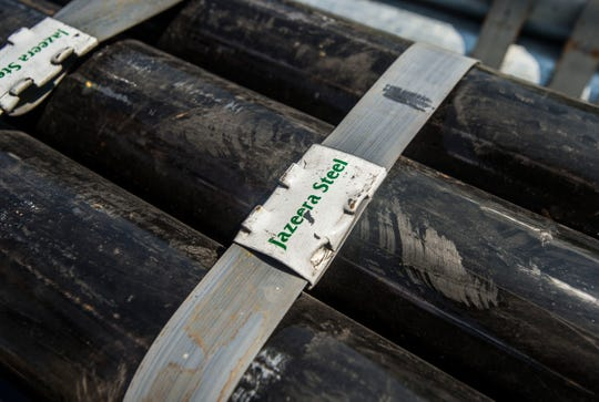 Steel pipes at Queen City Steel in Burlington, Vt., that were imported from the Middle East now carry a tariff.