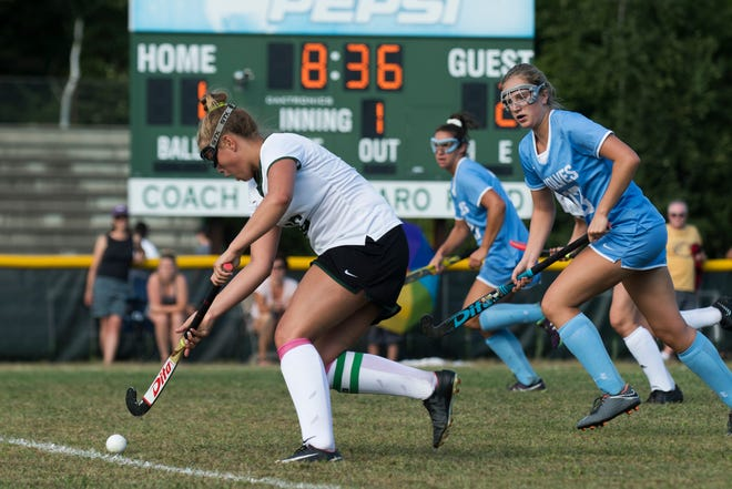Rice's Kate Buckley (16) runs down the field with the ball during the girls field hockey game between the South Burlington Wolves and the Rice Green Knights at Rice Memorial High School on Tuesday afternoon September 4, 2018 in South Burlington.