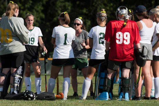 Rice head coach Kelly McClintock talks to the team during a field hockey game between the South Burlington Wolves and the Rice Green Knights.