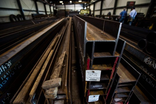 Steel beams sit in storage at Queen City Steel in Burlington, Vt., on Thursday, August 16, 2018. Owner Jeff Goldfield says some customers ordered steel for construction projects months ahead of time to head off President Trump's tariff action on Canadian metal imports.