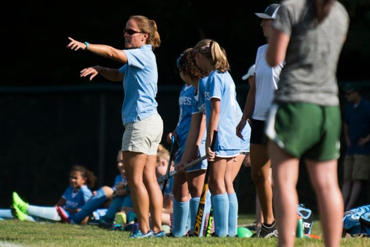 South Burlington head coach Anjie Soucy talks to the team on the field during the girls field hockey game between the South Burlington Wolves and the Rice Green Knights at Rice Memorial High School on Tuesday afternoon September 4, 2018 in South Burlington.