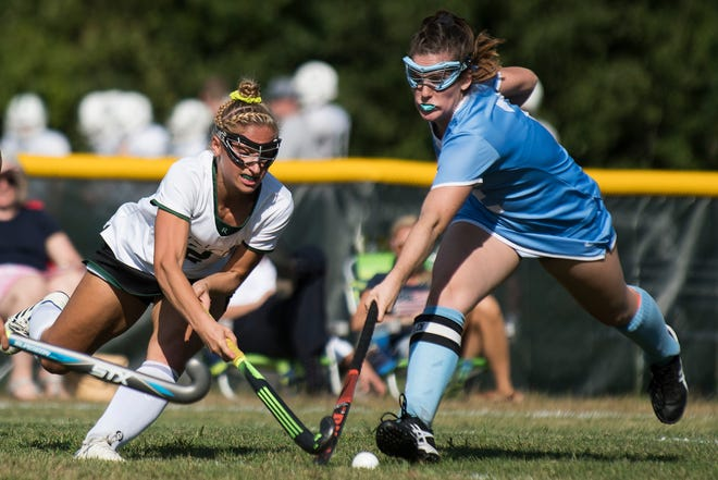 South Burlington's Kate Hall (2) and Rice's Lisa McNamara (2) battle for the ball during the girls field hockey game between the South Burlington Wolves and the Rice Green Knights at Rice Memorial High School on Tuesday afternoon September 4, 2018 in South Burlington.
