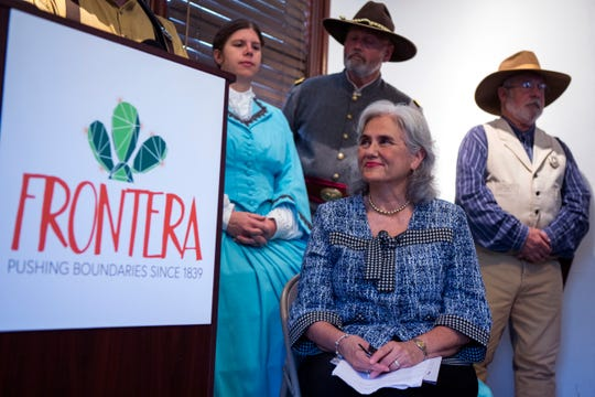 Cecilia Garcia Akers (center, front), the daughter of Dr. Hector P. Garcia, listens to details of the upcoming Frontera, an immersive festival that will feature the history of Corpus Christi and will be held November 2 to 4 during an announcement at Heritage Park on Wednesday, September 5, 2018. The event will feature a hip-hop musical on the life of her father. History reenactors were on hand for the event including Sally Howden-Attwood (from left), Bob Yeager and Douglas Crumly.