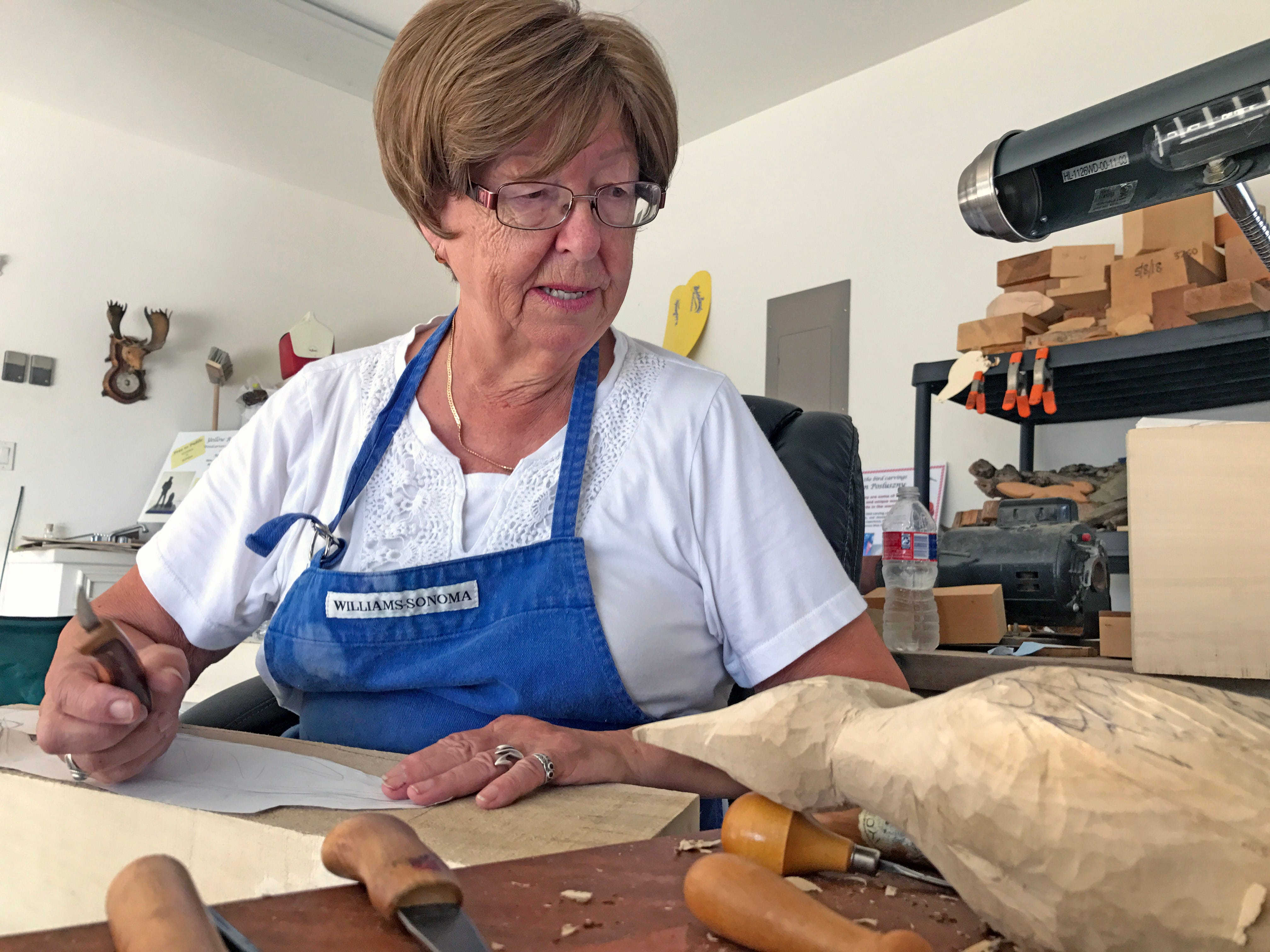 Posluszny, a retired nurse, began carving as a way to relieve stress from the job.